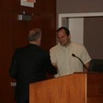 Prof. Christopher Clark presents the Harry J. Marks Fellowship to Erik Freeman