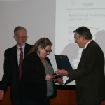 Prof. John Davis presents the Harry J. Marks Fellowship to Jessica Strom