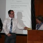 Prof. Sherri Olson presents the Undergraduate History Excellence Award to Harrison Fregeau