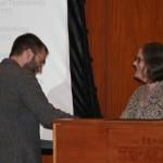 Prof. Nancy Shoemaker presents the Connecticut Celebration 350th Scholarship to Nathan Braccio