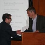 Prof. Mark Healey presents the Albert E. & Wilda E. Van Dusen Scholarship to Joreel Melendez-Badillo