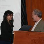 Prof. Peter Zarrow presents the Abraham and Faye Astor Scholarship to Yang Zheng