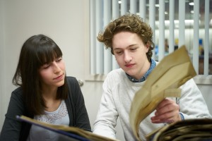 Helen Stec ('18 History) and Charlie Smart ('18) at the UConn Archives. Photo credit: Peter Morenus.